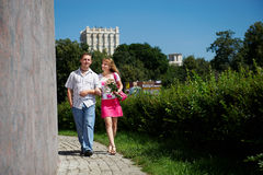 Young man and woman at romantic walk Royalty Free Stock Images