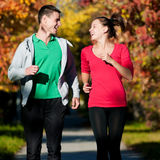 Young man and woman running Royalty Free Stock Photography