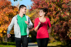 Young man and woman running Royalty Free Stock Photos