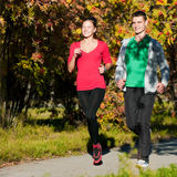 Young man and woman running Stock Photo