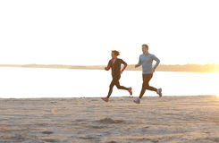 Young man and woman running along the waterfront Royalty Free Stock Images