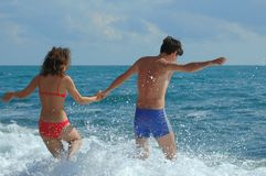 Young man and woman in the sea. Young man and woman going in the sea Stock Photo