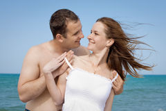 Young man and woman at the sea Royalty Free Stock Photo