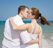 Young man and woman at the sea Royalty Free Stock Photography