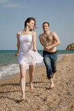 Young man and woman at the sea Royalty Free Stock Image
