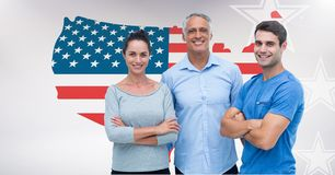 Young man and woman with senior man standing against American flag. Digital composition of young men and women with senior men standing against American flag Royalty Free Stock Image