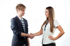 Young man and woman shaking hands Royalty Free Stock Photos