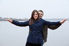 Young man and woman shore lake Royalty Free Stock Photos
