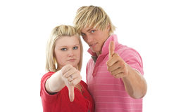 Young man and woman showing. Stock Photos