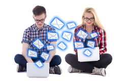 Young man and woman sitting with laptops and sending messages is. Young men and women sitting with laptops and sending messages isolated on white background Stock Photos