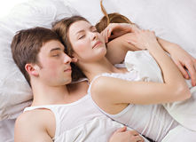 Young man and woman sleepping Stock Images