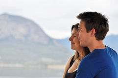 Young man & woman smiling on holiday Stock Photo