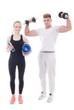 Young man and woman in sportswear with dumbbells and yoga mat is Royalty Free Stock Image
