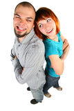 Young man and woman stand back to a back. And grimaced Royalty Free Stock Image