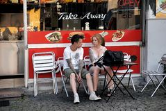 Young man and woman at street restaurant Stock Images