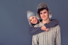 Young man and woman studio shoot on grey wall hugging royalty free stock photos