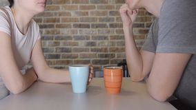 Young man and woman at the table drinking tea.  stock video footage