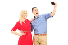 Young man and woman taking selfie with cell phone Royalty Free Stock Photos