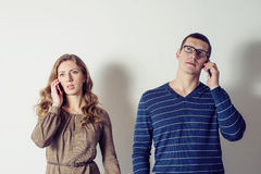 Young man and woman talking on the phone Royalty Free Stock Images