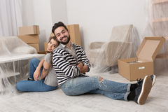 Young man and woman are tired after preparation for relocation. Young men and women are tired after preparation for relocation. Couple sitting on the floor back Royalty Free Stock Photos