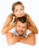 Young man and woman together over white background Stock Image