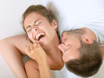 Young man and woman together over white background stock images
