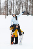 Young man and woman with treir snowboards Stock Photo
