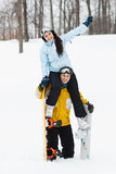 Young man and woman with treir snowboards Royalty Free Stock Photo
