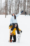 Young man and woman with treir snowboards Royalty Free Stock Photos