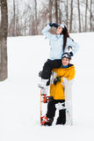 Young man and woman with treir snowboards Stock Photos