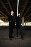 Young man and woman under highway road  Royalty Free Stock Photo