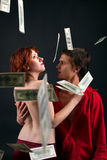 Young man and woman under money fall. Young man and naked woman under money fall Royalty Free Stock Photos