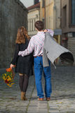 Young man and woman walking away together Royalty Free Stock Photo