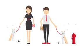 Young man and woman walking a dog Royalty Free Stock Photo