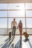 Young man and woman watching aircraft flight Stock Photos