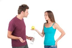 Young man and woman with water and apple. royalty free stock photography