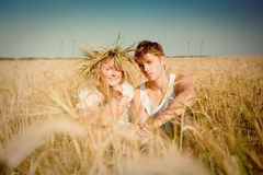 Young man and woman on wheat field Stock Photo