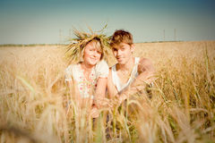 Young man and woman on wheat field Stock Photos