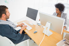 Young man and woman working on computers Royalty Free Stock Photography
