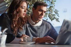 Young man and woman working in front of the laptop. Team meeting, work process. stock images