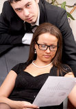 Young man and woman working in office Stock Photos