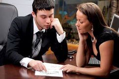 Young man and woman working together Stock Image
