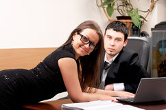 Young man and woman working together Royalty Free Stock Images