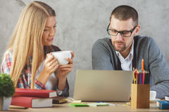 Young man and woman working together stock photos