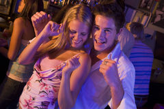 Young man and women dancing Royalty Free Stock Photo