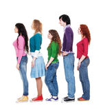 Young man and women in queue. Full length portrait of young man and women in queue against white background stock photos