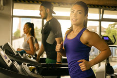 Young man and women workout in gym. Stock Images