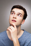 Young man wondering Stock Images