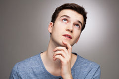 Young man wondering. Young man looking up and wondering Stock Image