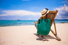 Young man in wooden chair beach during summer Stock Image